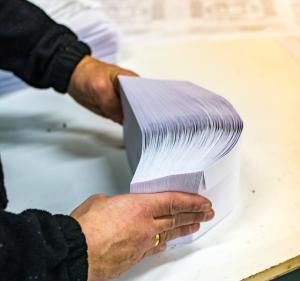 man sorting direct mail envelopes